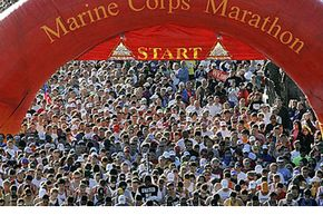 Runners stream over the starting line of the Marine Corps Marathon on Oct. 29, 2006. The 2010 Marine Corps Marathon sold out quickly, with 30,000 registrations in less than a week.
