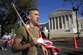 A participant in the Marine Corps Marathon passes the U.S. capitol on Oct. 28, 2001.