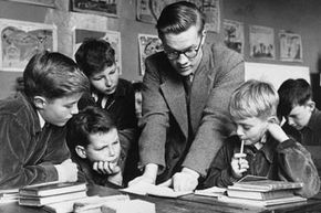 A teacher at work with a group at a school for orphans in London in 1958, around the time the National Child Development Study was started in the U.K.