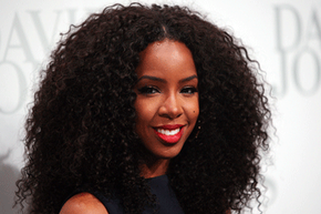 Singer Kelly Rowland sports a classic combo: a bright red matte color with a little black dress.