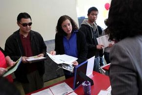 Skyline College students talk to a recruiter during a job fair in San Bruno, Calif. How can you stand out to MBA programs? See more college pictures.
