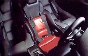 The McLaren F1 had a leather-lined interiror, with the driver centrally located in a formfitting seat, with room for passengers on either side.