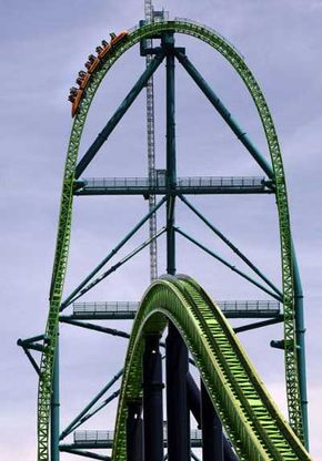 Riders pass the 45-story high summit of the Kingda Ka roller coaster at Six Flags Great Adventure in New Jersey.