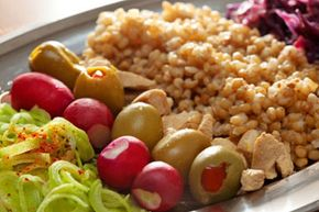 Mediterranean cuisine is about fresh, healthy foods and balanced meals. Onions, olives, chicken, whole grains, cabbage and loads of flavor mean this meal is sure to keep your taste buds entertained and your waistline in check. See more weight loss tips pictures.