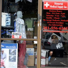A police officer gathers evidence at medical supply company believed to be involved in Medicare fraud in 2009.