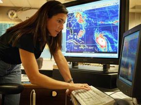 A meteorologist at the National Hurricane Tracking Center in Miami studies the movements of a powerful storm system in an effort to forecast its movements.