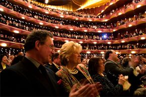 """The audience gives a standing ovation for the Metropolitan Opera's closing night performance of the opera """"Tosca"""" by Giacomo Puccini, in New York City, on May 11, 2002."""