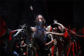 """In this April 9, 2010 photo, Renee Fleming, center, performs the title role during the final dress rehearsal of Gioachino Rossini's """"Armida"""" at the Metropolitan Opera in New York."""