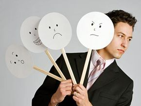 Think of microexpressions as this man's face. The expressions on the paper plates are what he chooses to show to you, but you might see microexpressions of his true feelings underneath.