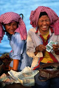 Women in developing nations, like these two entrepreneurs in Cambodia, are commonly the recipients of microloans.