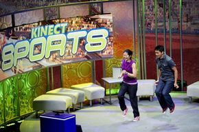In June 2010, two players demonstrate how the Kinect Sports game uses the controller-free motion-detection in Microsoft Kinect. See more video game system pictures.