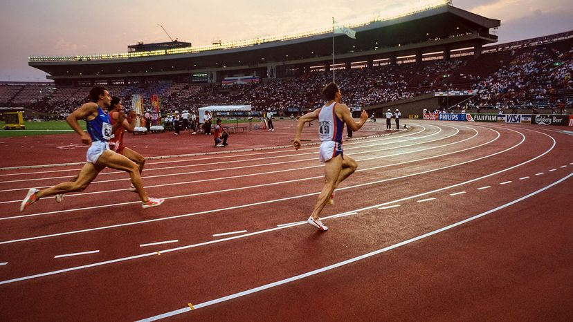 Runners in lanes on track