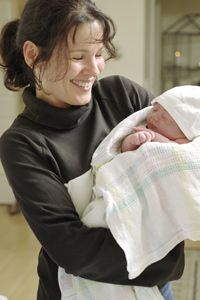 Image Gallery: Baby Care A midwife with a newborn baby. See baby care pictures.