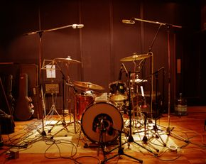 Each drum should be miked separately, but cymbals don't require mics.