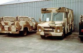 Military vehicles painted with a desert camouflage design for use in Operation Desert Storm