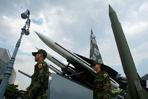 South Korean soldiers walk past scrapped missiles at a war museum in Seoul, South Korea.