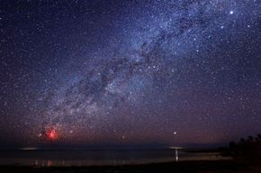 The Milky Way, from the bright star Sirius in the upper right corner all the way down to Eta Carina, the red nebula visible on the horizon, as seen from the Florida Keys. See more pictures of the Milky Way.