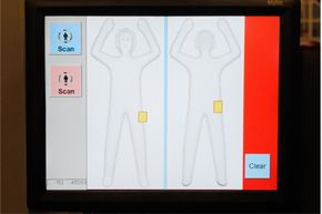 This monitor at the Las Vegas airport in February 2011 displays the automated target recognition software responsible for creating a generic display of a person's body. Compare that visual with the more detailed mmw image of the body on the next page.