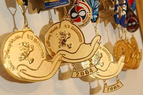 Donald Duck medals that Dale Nelson earned from running in the Walt Disney World Half-Marathon hang in his home in Orlando, Fla. Dale and his wife, Betsy, left their law enforcement jobs in Ft. Lauderdale to move closer to Walt Disney World.