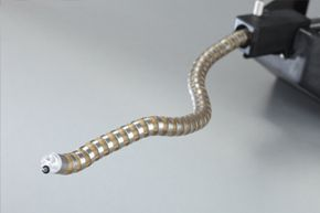 The snake-shaped 'CardioARM' robot can wrap itself around organs and worm through intestines, bronchial tubes and other pathways used during endoscopic surgery.