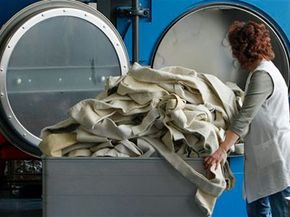 Germany passed minimum wage laws in early 2009 that covered workers in very specific industries, like this woman at an industrial laundry.