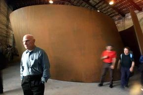 Richard Serra is known for his massive sculptures. Here, he poses in front of one in the pavillon of the 49th International Art Exhibition in Venice in 2001.