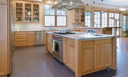 An island can add some much needed counter space, but if it's too big, it can ruin your kitchen.