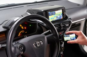 Once everything is all hooked up, you can use the buttons in the center console and even the buttons on the steering wheel to control your phone.