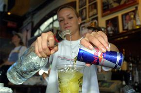Bartender Crystal Petersen mixes a Red Bull with vodka. The energy drink is a popular chaser in nightclubs, but the combination can mask how drunk you really are.