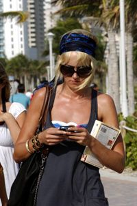 Mobile broadband services let users like reality star Kimberly Stewart keep track of e-mail while on the go.