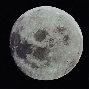 Looking at the full moon, you can clearly see dark areas (maria) and light ones (terrae). See more moon images.