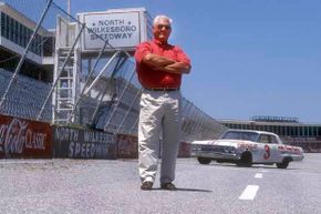 NASCAR legend Junior Johnson with his 427 Mystery Motor Chevrolet. Johnson started out as a bootlegger before making it big in NASCAR.