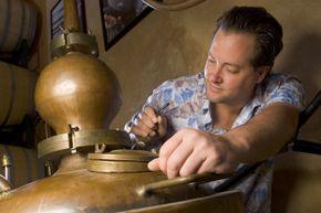 Thirteenth generation distiller Marko Karakasevic makes adjustments to his handmade copper still. He runs a family business making whiskey and other spirits legally.