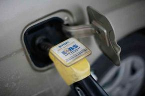 E85 ethanol fuel is pumped into a vehicle at a gas station selling alternative fuels in the town of Nevada, Iowa.