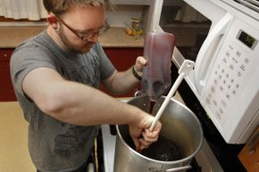 Ryan Beck of Minneapolis has been brewing beer in his home for about seven years and now has it down to a science.