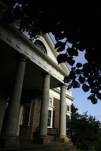 The portico seen here could have been used as a sun room when louvered blinds were lowered from the columns.