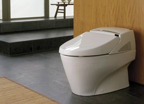 The tankless Neorest 600 toilet offers hands-free bathroom experience. A remote control adjusts the features for each user.