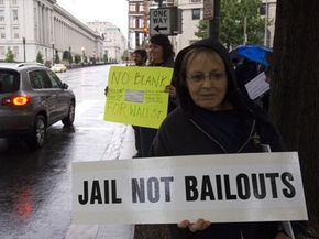 A protester opposes the federal bailouts of investment banks and mortgage buyers in Washington in September 2008.