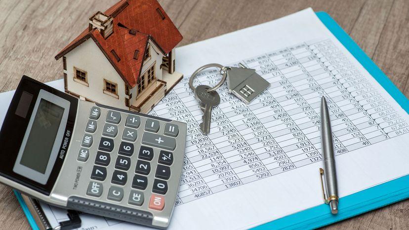 concept houses, calculator, paperwork