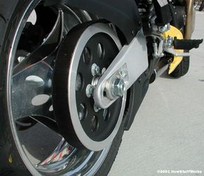This motorcycle's transmission connects to the rear wheel with a belt drive system.