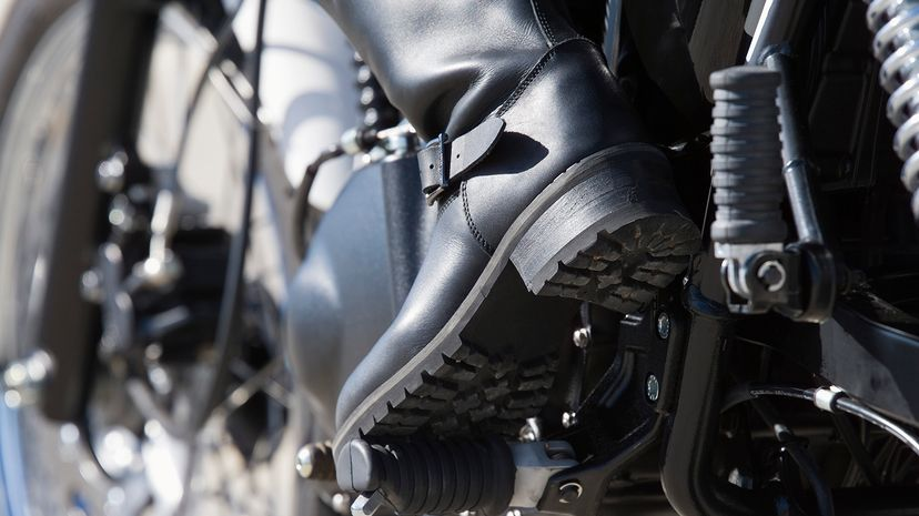 motorcycle boot on peda