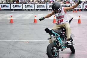 A rider for a stunt team performs hands-free tricks on his motorcycle. Marcello Sarandrea (not pictured) set the record for the longest hands-free motorcycle ride.