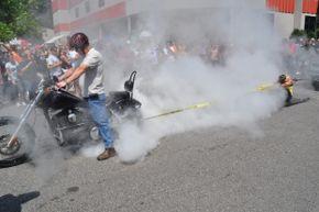 Juli Moody restrains a motorcycle at Ray Price Harley-Davidson in Raleigh, North Carolina.
