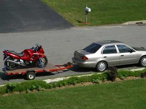 Flatbed trailers provide an excellent means of motorcycle trailer towing.
