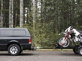 Don't care to drive those bikes through the forest? The two-wheel motorcycle towing trailer may save the day.