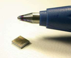 """""""Spec"""" pictured beside the tip of a ballpoint pen."""