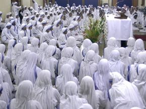 Nuns of the global Missionaries of Charity Order, founded by Nobel Peace Prize winner Mother Teresa, take part in a thanksgiving mass at Mother House in Calcutta, India, on Oct. 19, 2003.