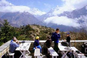 Image Gallery: Mount Everest Tourists look out at Mount Everest and the Himalayas. Tourism accounts for 4 percent of Nepal's Gross National Product. See more pictures of Mount Everest.