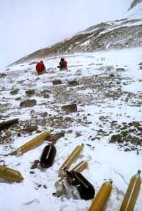 Discarded oxygen tanks litter the slopes of Mount Everest.