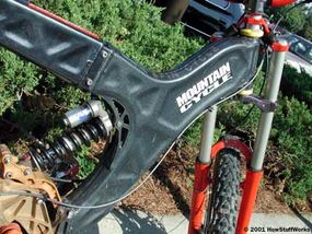 The main section of the frame on this downhill racing bike is made by welding two stamped aluminum pieces back to back.